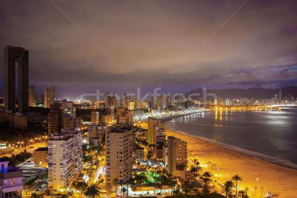 Panorama of the coastal city at sunset with lights reflected in sea Stock photo © artjazz