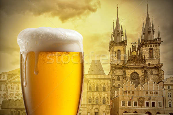 Glass of beer against Tyn Church in Prague Stock photo © artjazz