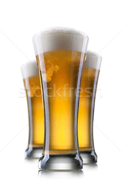 Beer in glass isolated on white Stock photo © artjazz