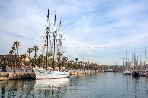 Yachts near Pier on calm water with reflecting Stock photo © artjazz