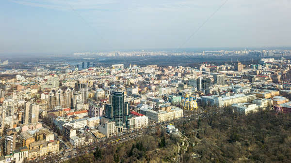City of Kiev on a sunny day. Modern high-rise buildings and a park. Aerial photo from the drone Stock photo © artjazz