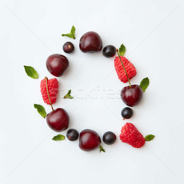 Colorful fruits pattern of letter Q english alphabet from natural ripe berries - black currant, cher Stock photo © artjazz