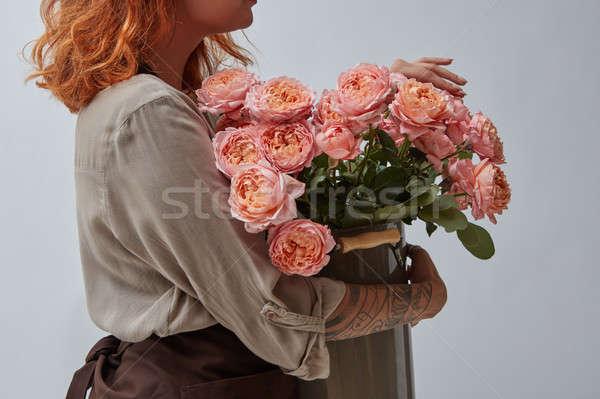 Nina florista ramo rosa rosas Foto stock © artjazz