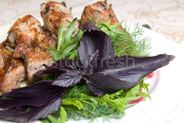 fried meat with potherbs on the plate Stock photo © artjazz
