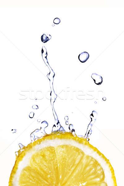 Frischwasser Tropfen Zitrone isoliert weiß Essen Stock foto © artjazz