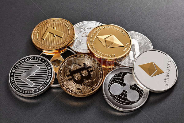 Different coins of crypto currency on a dark background Stock photo © artjazz
