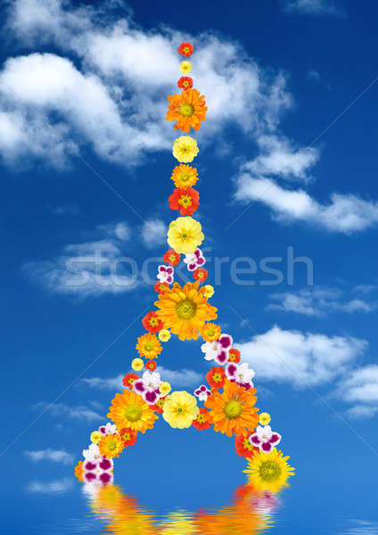 eiffel tower from flowers with reflection against blue sky Stock photo © artjazz