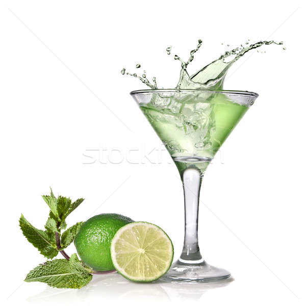 Green alcohol cocktail with splash, lime and mint isolated on wh Stock photo © artjazz
