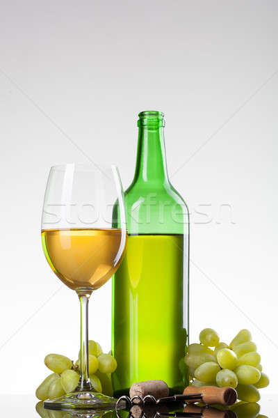 White wine in glass with grape and bottle Stock photo © artjazz