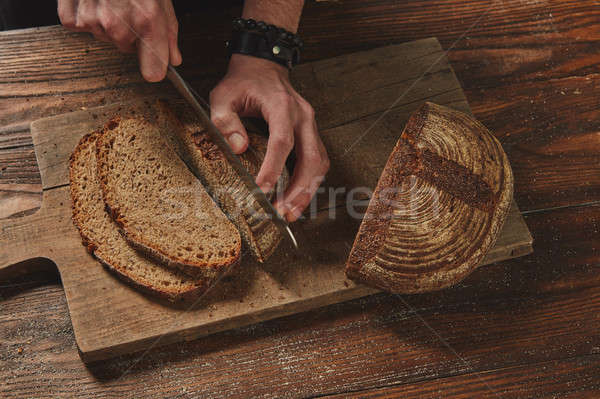 Baker Slicing Bran Bread Stock photo © artjazz