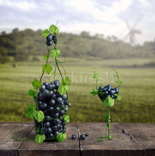 grapes and one glass of wine of the vineyard on a wooden old background Stock photo © artjazz
