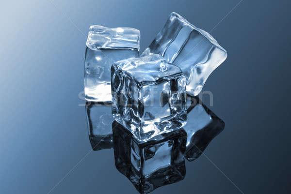 ice cubes on blue Stock photo © artjazz