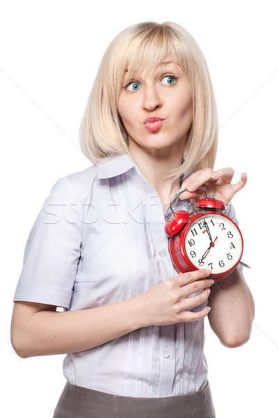 A beautiful young woman with alarm clock isolated on white Stock photo © artjazz