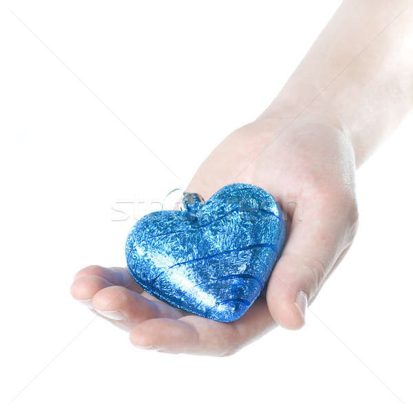 arm holding blue christmas ball in shape of heart isolated on white Stock photo © artjazz