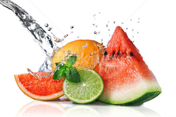 Water splash on  fresh fruits isolated on white Stock photo © artjazz