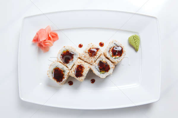 Maki Sushi on plate isolated on white Stock photo © artjazz