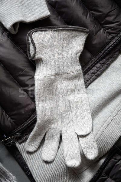 Knitted woollen grey gloves Stock photo © artjazz