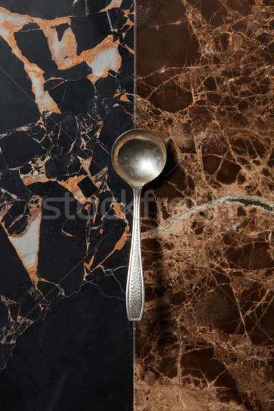 spoon on a marble background Stock photo © artjazz