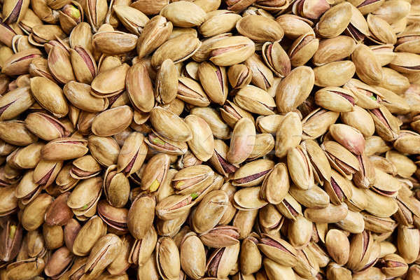 Roasted and salted pistachios in shell Stock photo © artjazz