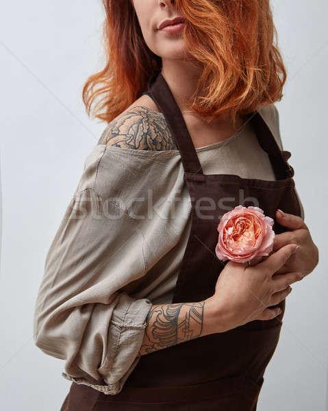 Dziewczyna różowy kwiat strony cute tatuaż szary Zdjęcia stock © artjazz
