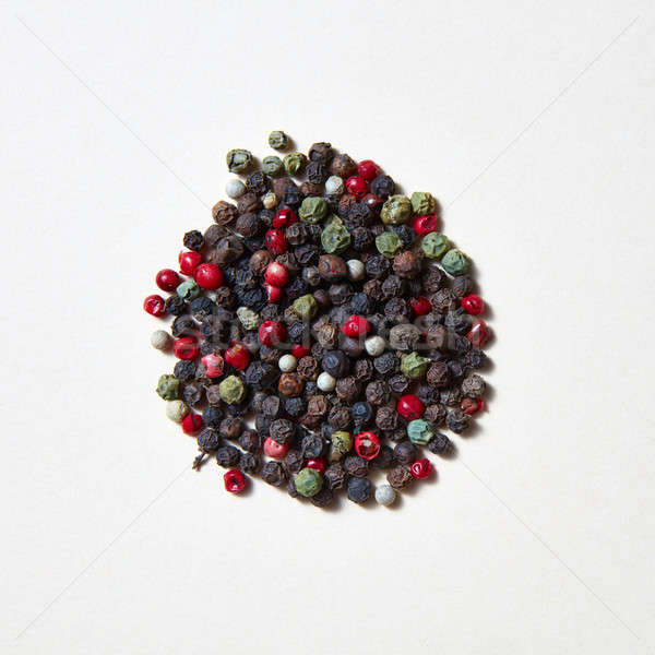 Flavouring pattern of different kinds of pepper -black, green, red, white isolated on a white backgr Stock photo © artjazz