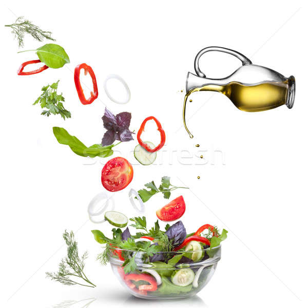 Falling vegetables for salad and oil isolated on white  Stock photo © artjazz