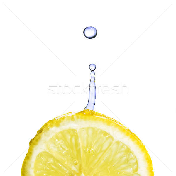 Eau douce chute citron isolé blanche alimentaire Photo stock © artjazz