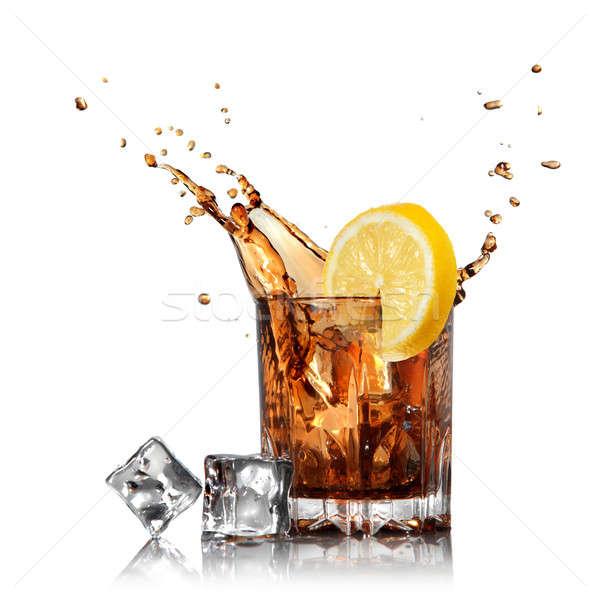 Splash cola szkła cytryny lodu odizolowany Zdjęcia stock © artjazz