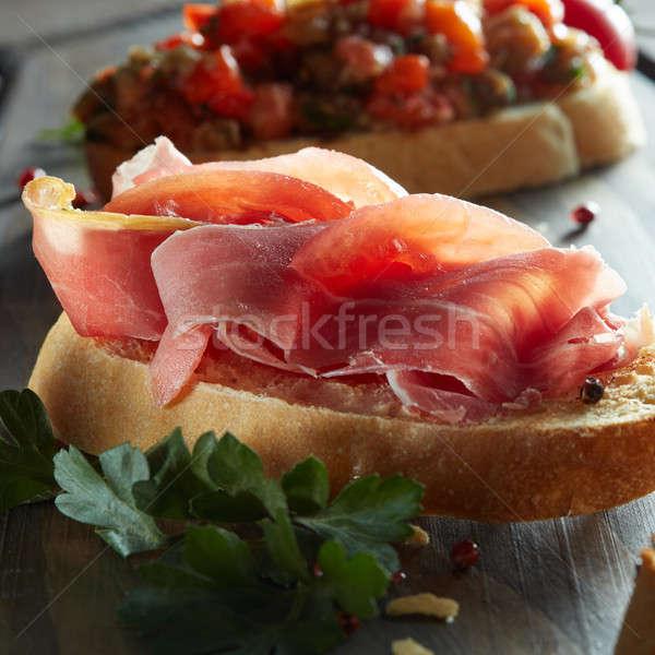 Olasz étel bruschetta olasz sonka sötét fából készült Stock fotó © artjazz