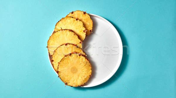 Apetyczny plastry ananas biały tablicy niebieski Zdjęcia stock © artjazz