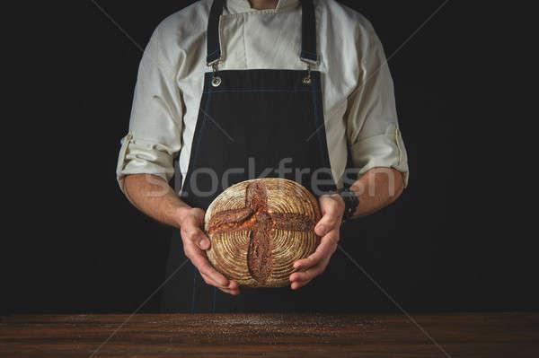 fresh round bread male hands holding Stock photo © artjazz
