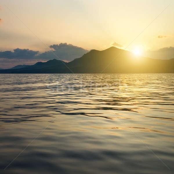 ストックフォト: 風景 · 海 · 山 · 日没 · 太陽 · 光
