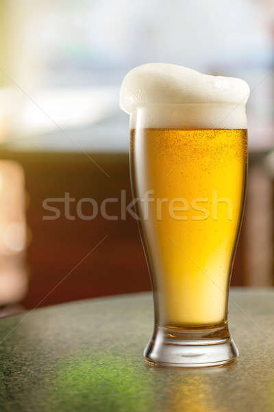 Glass of light beer in pub Stock photo © artjazz