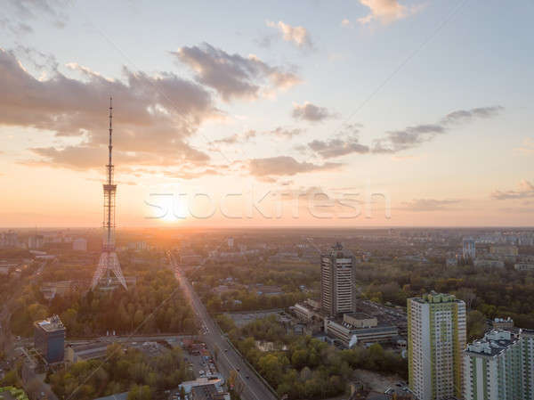 view of the city of Kiev with Dorogozhychi distric with a TV tower on sunset Stock photo © artjazz