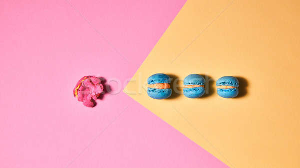 A bright composition of blue macaroons and one crushed pink maca Stock photo © artjazz