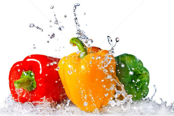 red, yellow and green pepper with water splash isolated on white Stock photo © artjazz