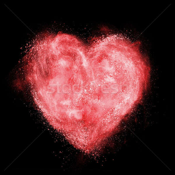 red heart made of white powder explosion isolated on black Stock photo © artjazz