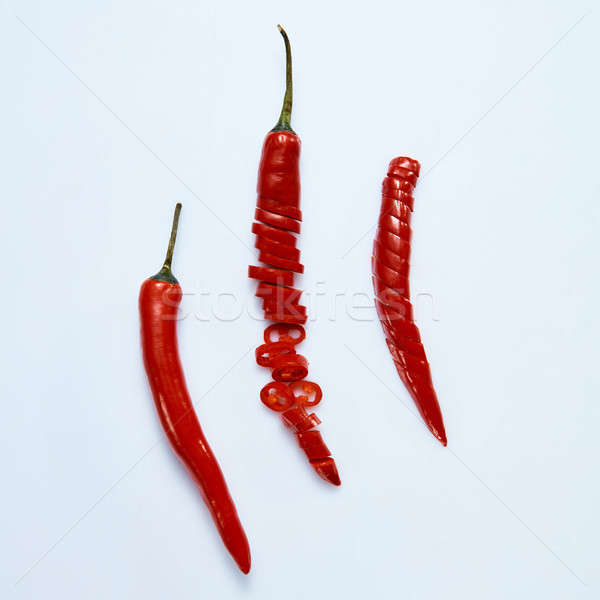 Group of red hot chili pepper on a gray background Stock photo © artjazz