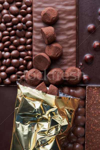 Chocolate candies poured on the background Stock photo © artjazz