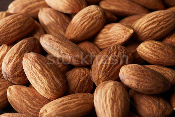 grain scattered handful of almonds close up Stock photo © artjazz