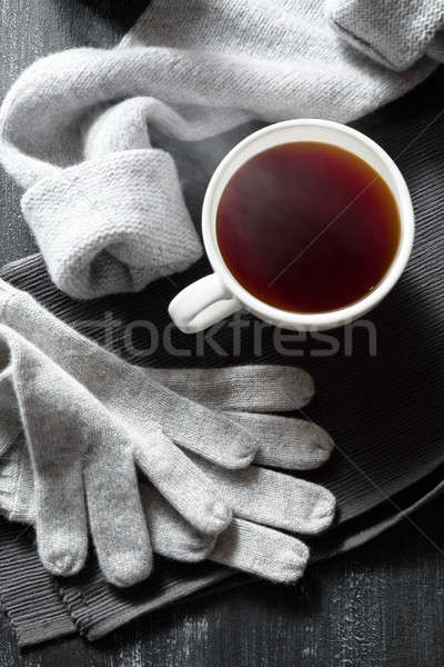 Coffee cup and handmade knitted things on a black background. Stock photo © artjazz