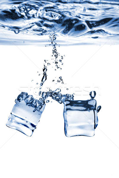ice cubes dropped into water with bubbles isolated on white Stock photo © artjazz