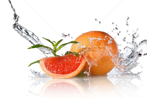 Grejpfrut mięty odizolowany splash Zdjęcia stock © artjazz