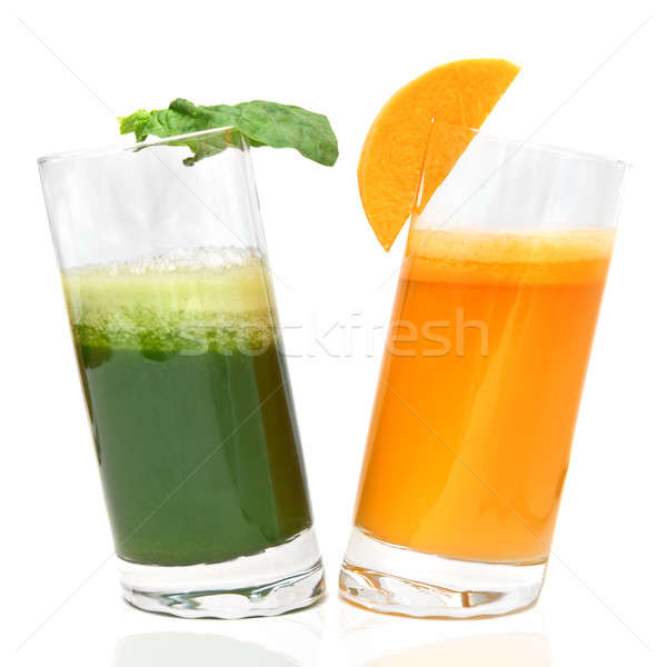 fresh juices from carrot and parsley in glasses isolated on white Stock photo © artjazz
