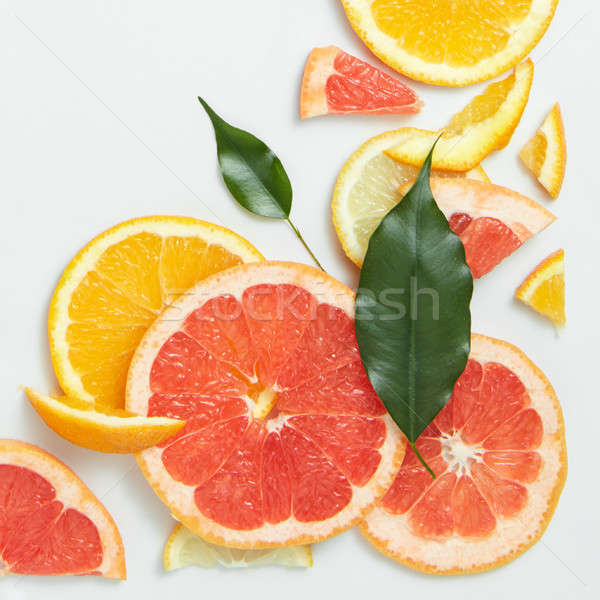 Close up of fresh citrus slices and leaf Stock photo © artjazz