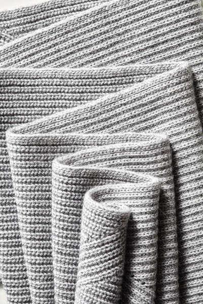 Draped melange gray woolen knitted fabric as background. Stock photo © artjazz