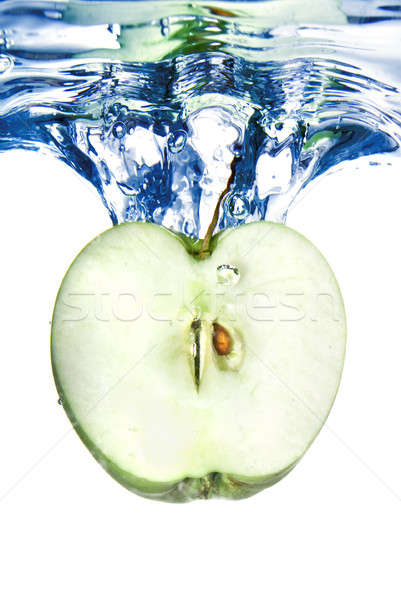 green apple dropped into blue water with splash isolated on white Stock photo © artjazz