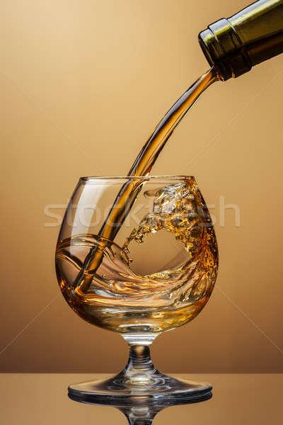 Koniak butelki szkła splash brązowy Zdjęcia stock © artjazz