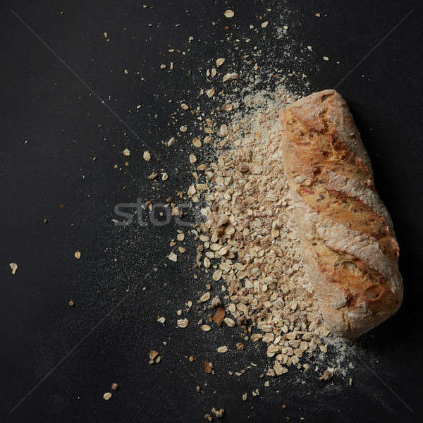 Loaf of bread with sprinkled flour Stock photo © artjazz