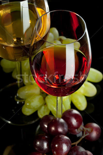 Red and white wine in glasses with grape. Top view Stock photo © artjazz